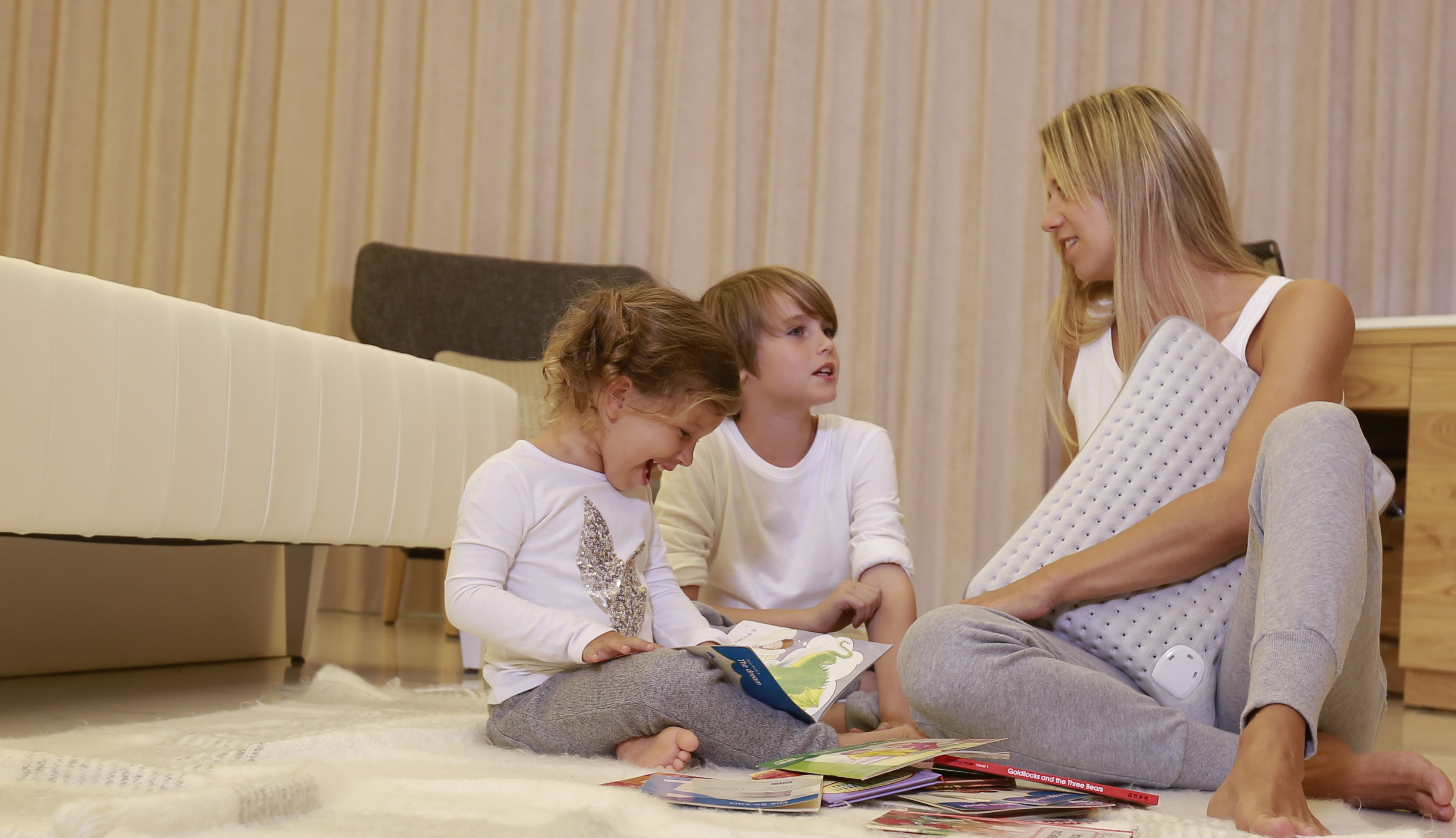 family using heating cushion