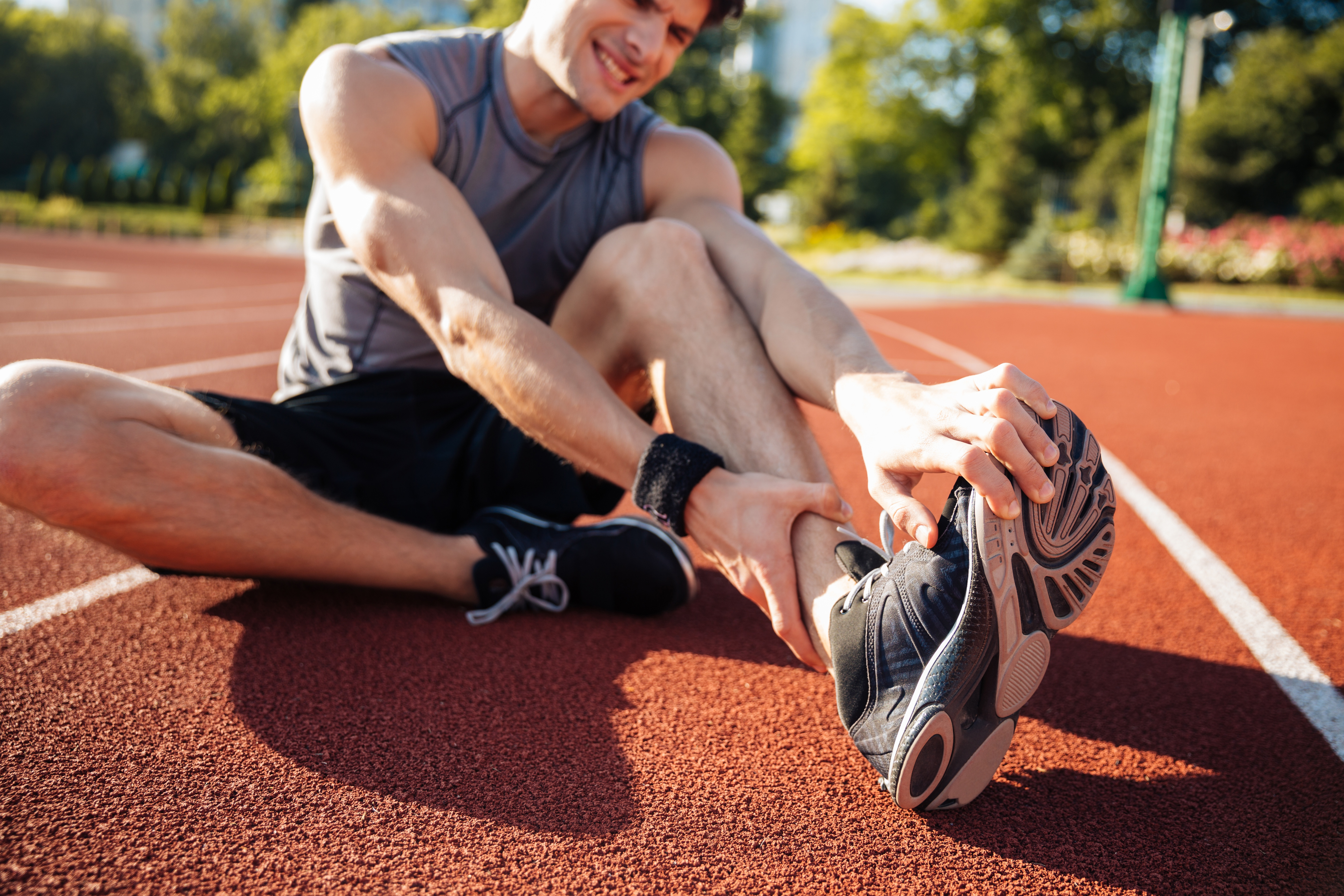 graphicstock-cropped-image-of-a-runner-suffering-from-leg-cramp-at-the-stadium_SuWfIeXrhx.jpg
